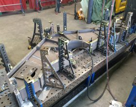 setting up on welding system's table